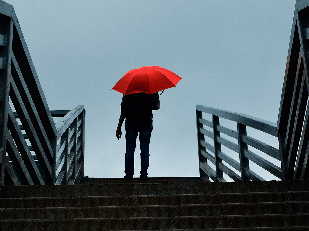 picture of a person holding red umbrella